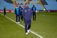 Wimbledon defender Adedeji Oshilaja (4)  arrives with his team mates during the EFL Sky Bet League 1 match between Coventry City and AFC Wimbledon at the Ricoh Arena, Coventry, England on 12 January 2019.