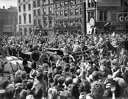The scene at Ludgate Circus, London, as King George VI and Queen Elizabeth wave to well wishers as they make their way to St. Paul's Cathedral to celebrate their silver wedding anniversary.