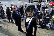 LIVERPOOL, ENGLAND, UNITED KINGDOM: Yoko Ono attends a photocall on the steps of St Luke's Cathedral under one of her controversial images which she has donated to the 3rd Liverpool Biennial, the UK's largest contemporary arts event which commences on September 18, 2004 and runs until November 28. The image is being used to promote the Biennial...Photograph © Colin McPherson, 17/09/04..Tel. +44 (0)7831 838717..Email: cmc1964@aol.com