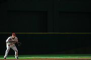 Aug 20, 2011; Houston, TX, USA; Houston Astros shortstop Clint Barmes (12) waits for the pitch against the San Francisco Giants in the first inning at Minute Maid Park. Mandatory Credit: Thomas Campbell-US PRESSWIRE