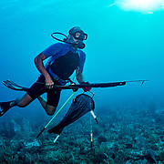 Commercial fisherman Andres Maldonado goes on the hunt for lobster, conch, and various fish species off Cabo Rojo, Puerto Rico. He noticed drastic and obvious declines in fish numbers and habitat availbale after Hurricane Maria in 2017 which put many other commercial fisherman out of business. Image release available.