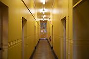 Yellow corridor interior at the Friends Institute in Birmingham, United Kingdom.