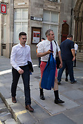 As heatwave temperatures climb to record levels - the hottest day of the year so far - Londoners in the City of London (the capital's financial district aka the Square Mile) took to wear informal dress codes including shorts and sports shirts, on 25th July 2019, in London, England.