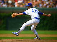 CHICAGO - 1986:  Dennis Eckersley #43 of the Chicago Cubs pitches during an MLB game at Wrigley Field in Chicago, Illinois.  Eckersley played for the Cubs 1984-1986. (Photo by Ron Vesely)