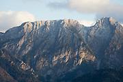 A distant landscape of mountain ridges and peaks in the Tatra National Park that also borders Poland with Slovakia, seen from the village of Koscielisko, on 18th September 2019, Zakopane, Malopolska, Poland.