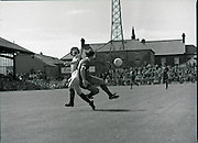 League of Ireland vs Liverpool FC.    (M87)..1979..18.08.1979..08.18.1979..18th August !979..In a pre season friendly the League of Ireland took on Liverpool FC at Dalymount Park Phibsborough,Dublin. The league team was made up of a selection of players from several League of Ireland clubs and was captained by the legendary John Giles. Liverpool won the game by 2 goals to nil..The scorers were Hansen and McDermott..Image of Liverpool's David Johnson and the league's John McCormack tussle for control of the ball.