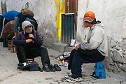 La Paz, Bolivia is home to thousands of shoe shine boys who work on the street all over the city. There are so ubiquitous that they represent their own subculture, their trademark being that they hide their faces due to discrimination from the stigma of being a lustrabota. Hormigon Armado is a street paper that functions like the Big Issue, covering issues relating to the shoe shine boys and life on the street, and they sell the paper and keep the money.