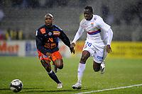 FOOTBALL - FRENCH CHAMPIONSHIP 2009/2010  - L1 - OLYMPIQUE LYONNAIS v MONTPELLIER HSC - 23/12/2009 - PHOTO JEAN MARIE HERVIO / DPPI - ALY CISSOKHO (OL) / SOULEYMANE CAMARA (MON)