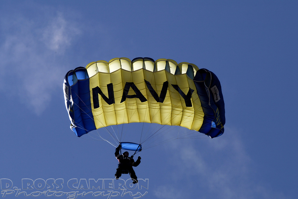 A U.S. Navy paratrooper floats down to the field of Candlestick Park during halftime of an NFL football game between the San Francisco 49ers and St. Louis Rams, Sunday, Sept. 11, 2005 at Candlestick Park in San Francisco. The 49ers won their regular season opener, 28-25. (D. Ross Cameron/the Oakland Tribune)