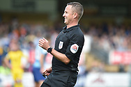 The referee has a laugh during the EFL Sky Bet League 1 match between Wycombe Wanderers and Oxford United at Adams Park, High Wycombe, England on 15 September 2018.
