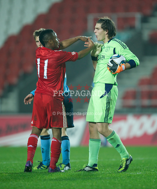 ST HELENS, ENGLAND - Wednesday, March 14, 2012: Liverpool's Raheem Sterling clashes with AFC Ajax's goalkeeper Mickey Van der Hart during the NextGen Series Semi-Final match at Langtree Park. (Pic by David Rawcliffe/Propaganda)