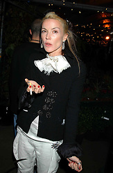 DAPHNE GUINNESS at an exclusive evening featuring the greatest talents in fashion today in aid of the African children who have been affected bt the AIDS epidemic held at the Chelsea Gardener, Sydney Street, London on 20th September 2004<br />