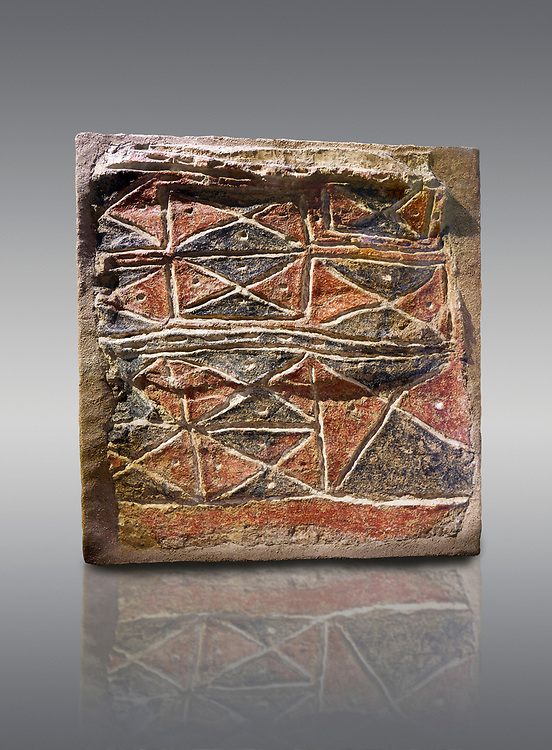 Wall fresco of geometric red and black triangles which appears to be a rug pattern copy. 6000 BC. . Catalhoyuk Collections. Museum of Anatolian Civilisations, Ankara. Against a grey background .<br /> <br /> If you prefer you can also buy from our ALAMY PHOTO LIBRARY  Collection visit : https://www.alamy.com/portfolio/paul-williams-funkystock/prehistoric-neolithic-art.html - Type Catalhoyuk into the LOWER SEARCH WITHIN GALLERY box. Refine search by adding background colour, place, museum etc.<br /> <br /> Visit our PREHISTORIC PLACES PHOTO COLLECTIONS for more  photos to download or buy as prints https://funkystock.photoshelter.com/gallery-collection/Prehistoric-Neolithic-Sites-Art-Artefacts-Pictures-Photos/C0000tfxw63zrUT4