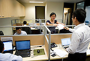 The staff works in Lunar Capital Management's Plaza 66 offices in Shanghai, China, on September 7, 2010. Photo by Lucas Schifres/Pictobank