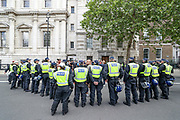 British police officers in riot gear form a cordon near Downing Street in central London, as members of far-right groups gather to counter-protest against a Black Lives Matter demonstration, Saturday, June 13, 2020. British police have imposed strict restrictions on groups planning to protest in London Saturday in a bid to avoid violent clashes between protesters from the Black Lives Matter movement, as well as far-right groups. (Photo/ Vudi Xhymshiti)