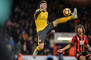 Arsenal Forward, Olivier Giroud (12) controls the ball during the Premier League match between Bournemouth and Arsenal at the Vitality Stadium, Bournemouth, England on 3 January 2017. Photo by Adam Rivers.