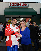 Dec 11,2012.  Montebello CA. USA.  Amir Khan(_C) greets fans  during media day Tuesday afternoon at the Ponce De Leon Boxing Club.  Amir Khan will be fighting Carlos Molina this Saturday night at the Los Angeles Sports Arena live on ShowTime. .Photo By Gene Blevins/LA Daily News