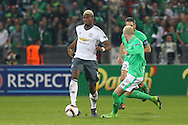 Paul Pogba Midfielder of Manchester United takes on Saint-Etienne Defender Loic Perrin during the Europa League match between Saint-Etienne and Manchester United at Stade Geoffroy Guichard, Saint-Etienne, France on 22 February 2017. Photo by Phil Duncan.