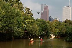 Buffalo Bayou kayaking from Buffalo Bayou Partnership Osprey on 8-30-13. Joe Martin and Alan Krathaus kayaking with Houston skyline background.