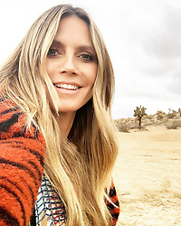"""Heidi Klum releases a photo on Instagram with the following caption: """"And that\u2019s a wrap !!!!!\nWishing everyone a great weekend \ud83d\ude18\ud83d\udc8b"""". Photo Credit: Instagram *** No USA Distribution *** For Editorial Use Only *** Not to be Published in Books or Photo Books ***  Please note: Fees charged by the agency are for the agency's services only, and do not, nor are they intended to, convey to the user any ownership of Copyright or License in the material. The agency does not claim any ownership including but not limited to Copyright or License in the attached material. By publishing this material you expressly agree to indemnify and to hold the agency and its directors, shareholders and employees harmless from any loss, claims, damages, demands, expenses (including legal fees), or any causes of action or allegation against the agency arising out of or connected in any way with publication of the material."""