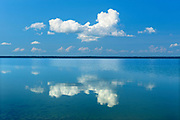 Clouds reflected in Simonhouse Lake, SImonhouse, Manitoba, Canada