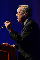 Richard C. Levin, Yale University President, at the Podium presenting a Visually Compasionate Speech. A Formal Dress Affair, the George H. W. Bush Blue Leadership Ball at Lanman Center, November 18, 2011. Excellent lighting and Background of a Profile View.