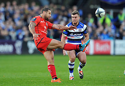 Luke McAllister of Toulouse puts boot to ball - Photo mandatory by-line: Patrick Khachfe/JMP - Mobile: 07966 386802 25/10/2014 - SPORT - RUGBY UNION - Bath - The Recreation Ground - Bath Rugby v Toulouse - European Rugby Champions Cup