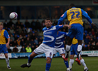Photo: Steve Bond/Sportsbeat Images.<br />Macclesfield Town v Hereford United. Coca Cola League 2. 26/12/2007. Theo Robinson (R) gets a header in as Luke Dimech (C) comes in to chllange