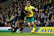Norwich City midfielder Marco Stiepermann (18) Wolverhampton Wanderers striker Bright Enobakhare (26) battles for possession during the EFL Sky Bet Championship match between Norwich City and Wolverhampton Wanderers at Carrow Road, Norwich, England on 31 October 2017. Photo by Phil Chaplin.