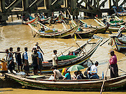 27 OCTOBER 2015 - YANGON, MYANMAR: Cross river ferries along Twante Canal in Yangon. The jetty is one of the numerous crossing points that bring people from the suburbs on the other side of the river into Yangon.    PHOTO BY JACK KURTZ