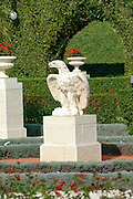 """Stone eagle in the gardens around the Shrine of Bahaullah Acre. Israel<br /> The most holy spot in the Bah?'? world: Bahji, near Acre, Israel, the resting place of Bah?'u'll?h's earthly remains. Surrounded by gardens, the mansion of Bahji (Arabic for """"delight"""" or """"joy"""") is visited by thousands of pilgrims every year. Their focus is the small garden house to the right of the main mansion, where Bah?'u'll?h's physical remains are buried."""