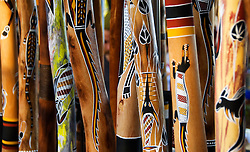 Ornate painted traditional Aboriginal Digeridoos for sale in Darwin Australia