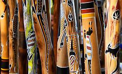 Ornate painted traditional Aboriginal Digeridoos for sale in Darwin Australia