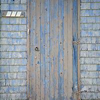 North America, Canda, Nova Scotia, Guysborough County. Yellow weathered door to home in Nova Scotia.