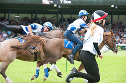 © Licensed to London News Pictures. 21/07/2015. Llanelwedd, UK. Teams of riders take part in theRoyal Welsh Mounted Games – International World Team Championships. The Royal Welsh Show is hailed as the largest & most prestigious event of it's kind in Europe. In excess of 200,000 visitors are expected this week over the four day show period - 2014 saw 237,694 visitors, 1,033 tradestands & a record 7,959 livestock exhibitors. The first ever show was at Aberystwyth in 1904 and attracted 442 livestock entries. Photo credit: Graham M. Lawrence/LNP