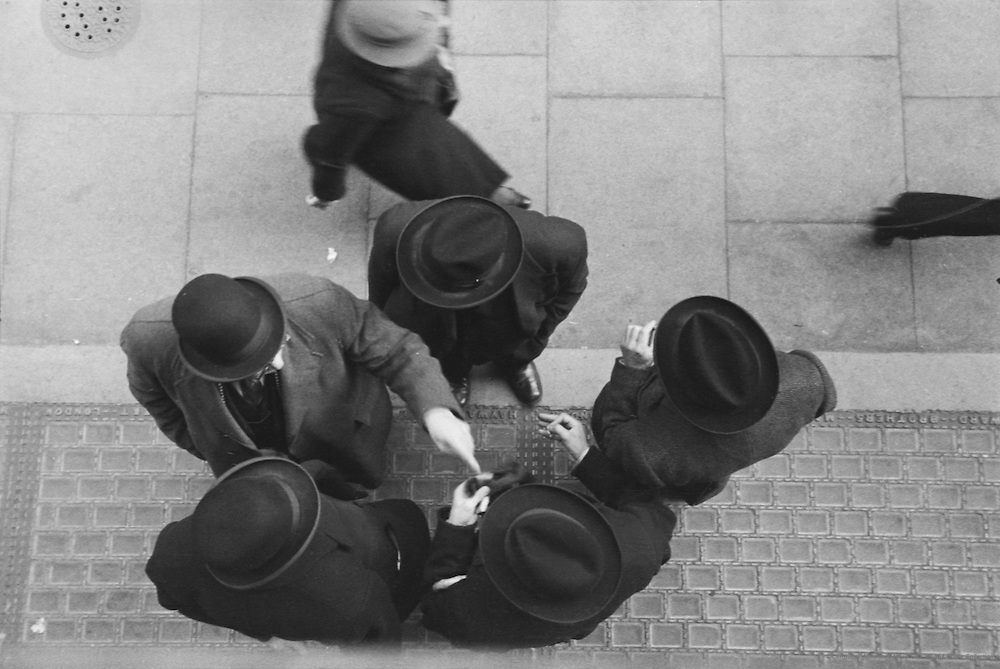 Men's hats seen from above - scenes at the Diamond Bourse, London, England, c. 1935