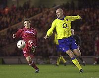 Fotball<br /> Middlesbrough v Arsenal. Carling Cup semi final second leg. <br /> Riverside Stadium, Middlesbrough. 03/02/2004.<br /> Boro's Juninho (L) aims a shot on goal despite the attentions of Pascal Cygan.