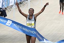 November 12, 2017 - Athens, Attica, Greece - Ethiopian Bedaru Badane finishes first in the Athens Marathon Women's race at the Panathenaic stadium in Athens, Greece, on Sunday November 12, 2017  (Credit Image: © Panayotis Tzamaros/NurPhoto via ZUMA Press)
