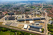 Nederland, Noord-Brabant, Eindhoven, 27-05-2013; Strijp-S, voormalige Philipsterrein, was niet toegankelijk voor het publiek, 'de verboden stad'. Het gebied, met diverse Rijksmonumenten, wordt ontwikkeld voor wonen, werken en cultuur.<br /> <br /> Onder in beeld Philitefabriek met Klokgebouw (Strijp S), in het midden het Veemgebouw met daar direct naast De Hoge (Witte) Rug. De weg rechts id de Beukenlaan. Rechts boven het midden het Evoluon.<br /> Strijp-S, former Philips area, was not accessible to the public, 'the forbidden city'. The area, with several national monuments, is designated for living, working and culture.<br /> Top image Philitefabriek / Clock Building (Strijp S), in the middle of the Veemgebouw next to the High (White) Back. <br /> <br /> luchtfoto (toeslag op standard tarieven);<br /> aerial photo (additional fee required);<br /> copyright foto/photo Siebe Swart