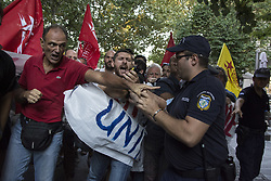September 7, 2017 - Athens, Greece - Protesters scuffle with police as they try to approach the location the President of France would address his speech. Leftists staged a demonstration to protest over Emmanuel Macron's visit in Athens, along with French businessmen, as they claim their aim is to privatize and buy Greek assets. (Credit Image: © Nikolas Georgiou via ZUMA Wire)