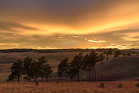 The sky turned to gold after sunset over the hills and grasslands of Wind Cave National Park.