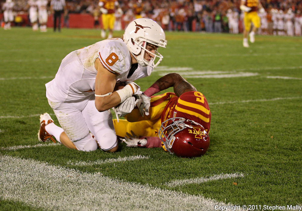 October 01, 2011: Texas Longhorns wide receiver Jaxon Shipley (8) pulls in a pass as Iowa State Cyclones defensive back Jeremy Reeves (5) defends during the second half of the game between the Iowa State Cyclones and the Texas Longhorns at Jack Trice Stadium in Ames, Iowa on Saturday, October 1, 2011. Texas defeated Iowa State 37-14.