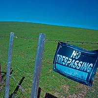 "A ""no trespassing"" sign blocks access to pastures near Martinez, California."
