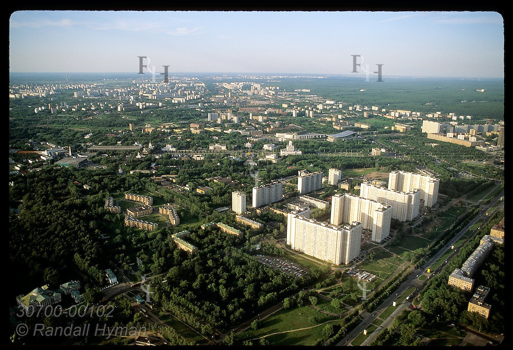 View from atop Ostankino TV tower of outer city limits in June reveals wealth of trees; Moscow. Russia