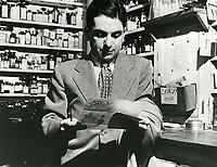 1945 Sidney Skolsky reading his mail at Schwab's Drugstore