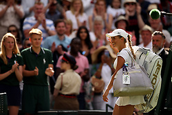 Yulia Putintseva waves to the crowd after beating Naomi Osaka on day one of the Wimbledon Championships at the All England Lawn Tennis and Croquet Club, Wimbledon.