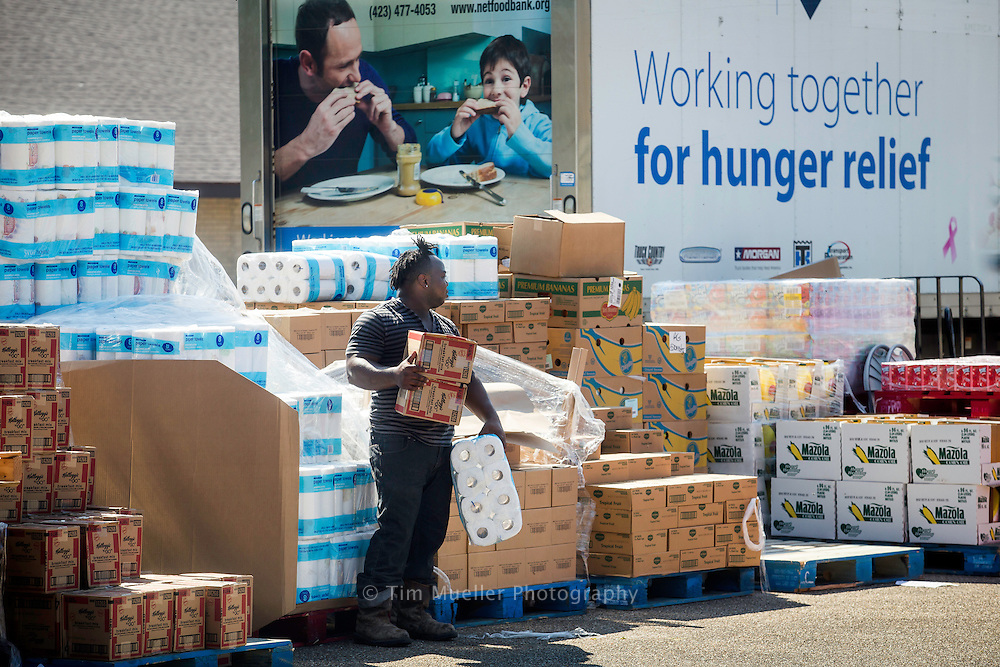Greater Baton Rouge Food Bank employee Dievetrick Vary stands ready to distribute commodities to Baker area residents Thursday, September 1, 2016 at Foster Road Baptist Church. As the Food Bank recovers from flood damage they are allocating food through neighborhood distribution centers and their member agencies.