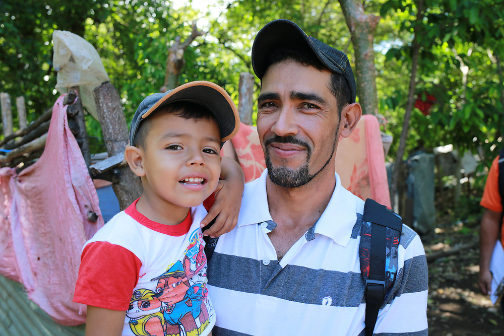 René Bermúdez has been taught by the CIEETS program supported by CWS to farm Melipona bees, a stingless bee that produces medicinal honey. This is a portrait of him with his son René Camilo.