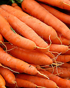 Organic orange carrots for sale at the  Common Ground Fair farmers market, Unity Maine.