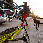 Jeff Brines gets ready to ride off of the top of Teton Pass with his Dog.